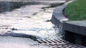 Image showing water flowing into Council stormwater drain